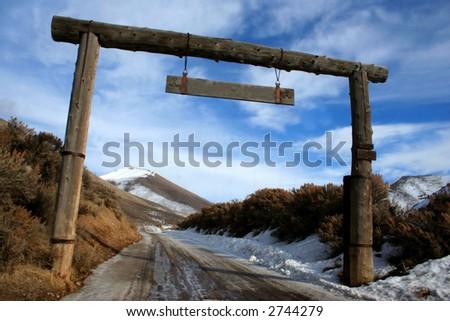Entrance to Idaho ranch in winter - stock photo