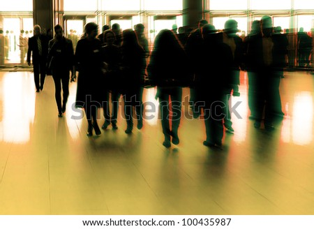 Entrance to modern building lobby and crowd silhouette - stock photo