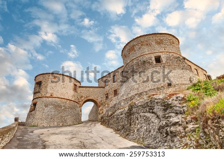 entrance to the ancient italian castle, the medieval fortress of Torriana, Rimini, Emilia Romagna, Italy   - stock photo