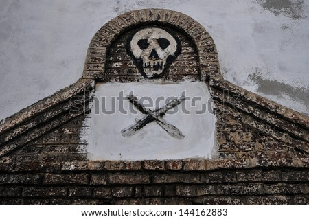 Entrance to the dungeon were male slaves were kept prior to transshipment. Elmina Castle (also called the Castle of St. George) is located on the Atlantic coast of Ghana west of the capital, Accra. - stock photo