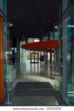 Entrance to the lobby in Polish Olympic Committee building. - stock photo