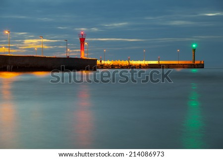Entrance to the port at night in ���eba Poland - stock photo
