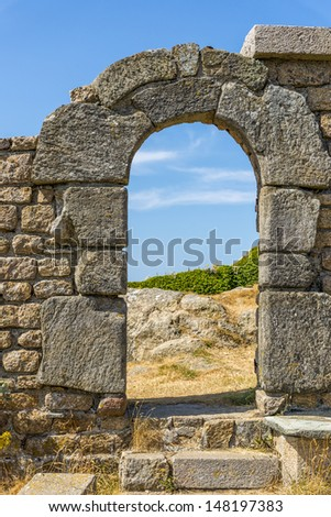 entrance to the ruins of an old fortress - stock photo