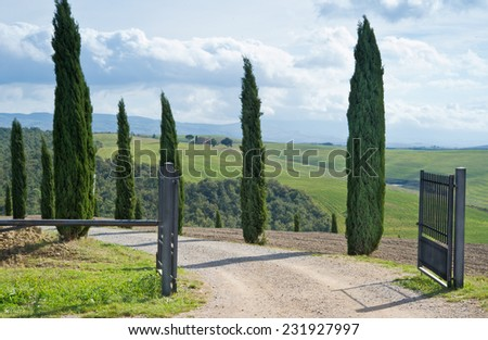 Entrance to the winery in Val d'Orcia, Tuscany. - stock photo
