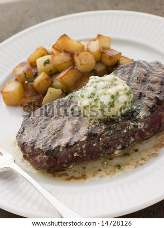 Entrecote de Beouf' with Roquefort Butter and Parmentier Potatoes - stock photo