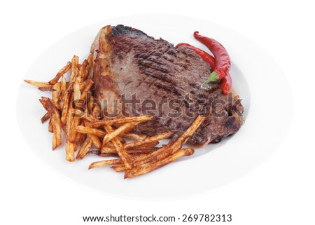 entree : grill beef meat steak on white round plate with dry hot chili pepper and potato chips isolated on white background - stock photo
