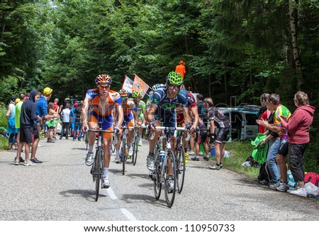 ENTREMONT,FRANCE-JULY 13 :Cyclists from Rabobank and Movistar Teams in front of the peloton climbing the mountain pass Granier in the 12 stage of Le Tour de France, on July 13, 2012 in Entremont, France. - stock photo