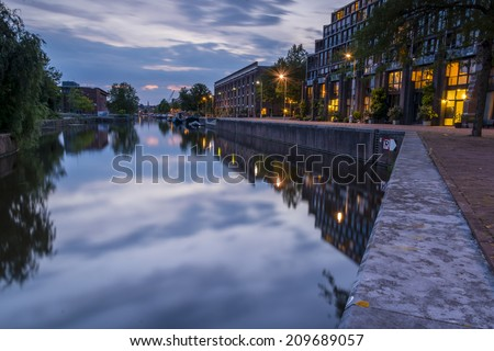 Entrepotdok canal, Amsterdam 4. Shortly after the sun had set on Nieuwevaart canal, I moved to another location- a more sheltered waterway where the reflections were beautiful. - stock photo