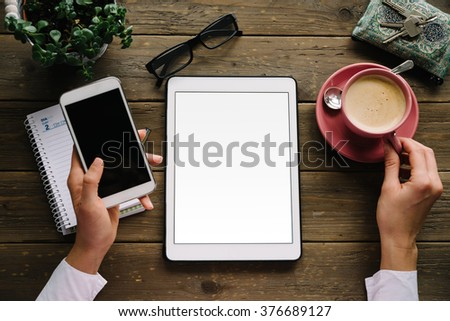 Entrepreneur working at home concept. Copy space blank digital tablet screen, smartphone and coffee cup on wooden desk. - stock photo