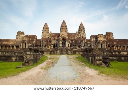 Entry in Angkor Wat in Cambodia against blue sky - stock photo