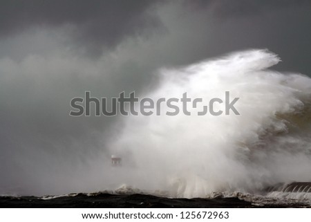 Entry of Douro River harbor on the first big storm of the year; Wind gusts reach 140 Km; photo taken on Jan. 19, 2013. - stock photo
