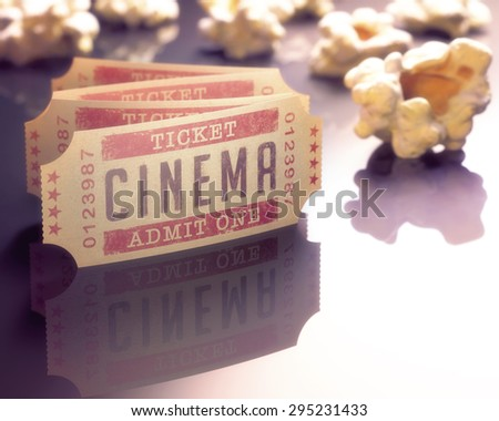 Entry ticket to the cinema with popcorn around. - stock photo