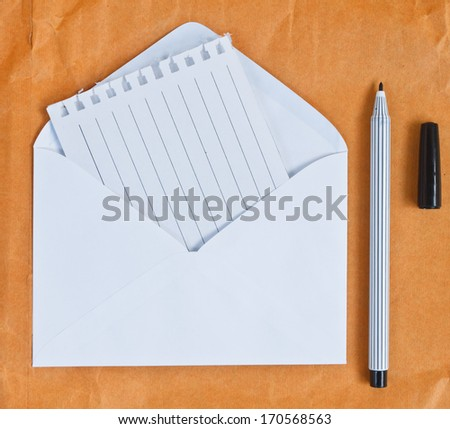 Envelope and pen - stock photo