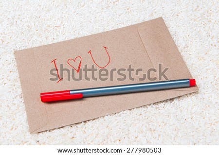 envelope and red pen on rice - stock photo