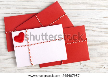 Envelope Mail with Red Heart and Ribbon over White Wooden Background. Valentine Day Card, Love or Wedding Greeting Concept. - stock photo
