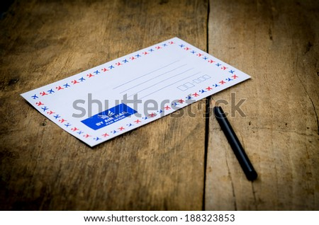 envelope on old wooden background - stock photo