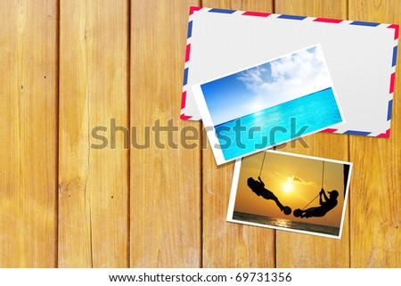 Envelope on the table wood - stock photo