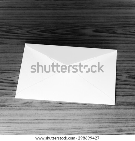 envelope on wooden background black and white color tone style - stock photo