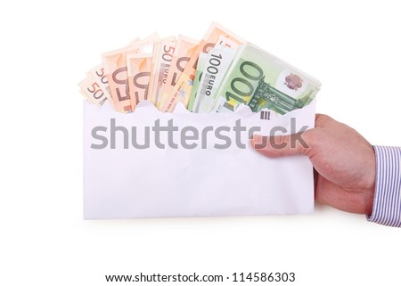 envelope with euro banknotes held by hand - stock photo
