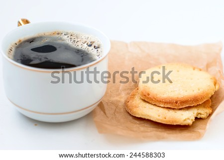 envelope with homemade cookies from parchment, cookies and and a cup of coffee on a white background, high key - stock photo