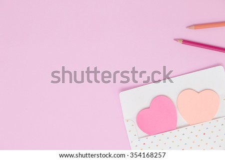 Envelope with paper note heart or post it for valentine day - stock photo