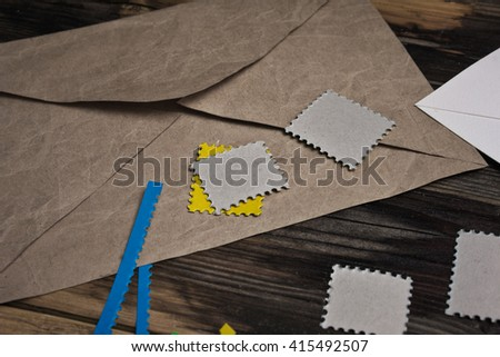 Envelope with stamps for sending messages - stock photo
