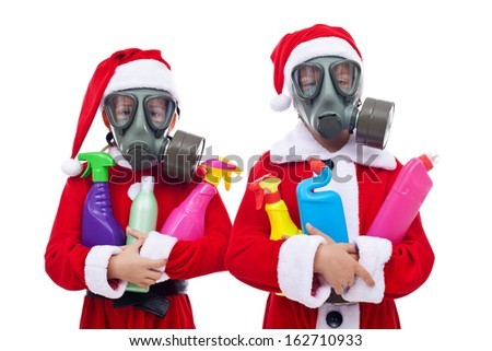 Environment concept with children in santa costume holding plastic waste bottles - isolated - stock photo