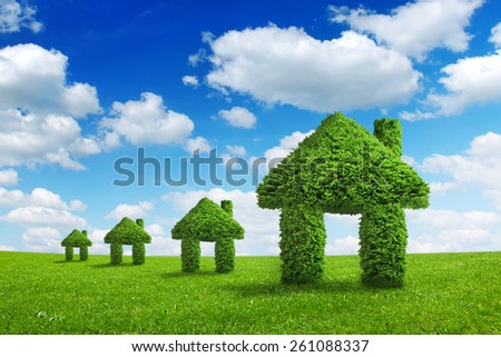 Environment ecology nature home integration concept. Green houses walking on a summer meadow under the blue sky  - stock photo