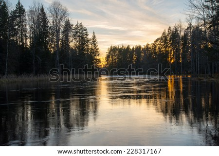 Environment of a river between autumn and winter at sunset - stock photo