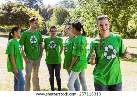 Environmental activist showing thumbs up on a sunny day - stock photo