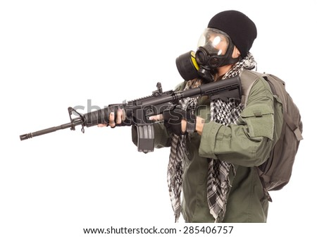 Environmental disaster. Post apocalyptic female survivor with gas mask, rifle and go bag. - stock photo