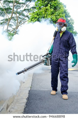 Environmental health workers are fogging to control dengue - stock photo