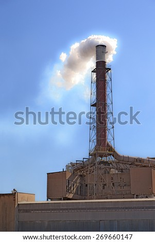 Environmental pollution and global warming by smoking chimney. - stock photo