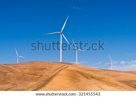 Environmental Windmills, Wind Turbines, Hill, Blue Sky,  - stock photo