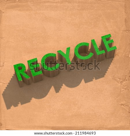 Environmentally friendly - Cardboard cut-out of the text RECYCLE - stock photo