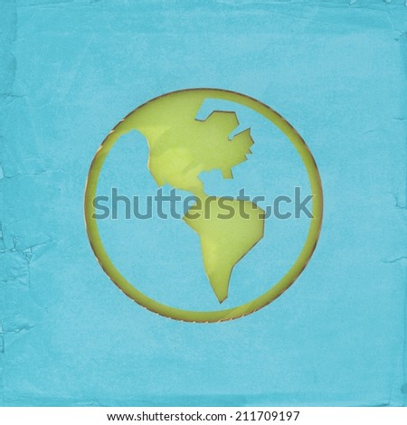 Environmentally friendly - Globe icon cut-out on cardboard - stock photo