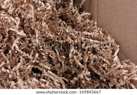 Environmentally Friendly Packing Material Brown Crinkle Cut Shred - stock photo