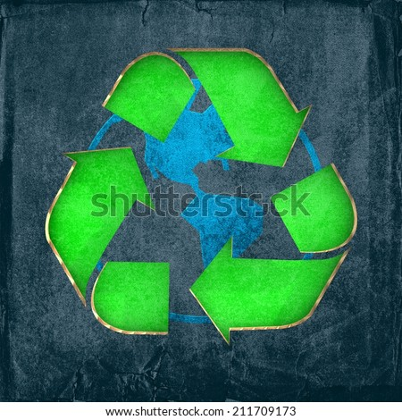 Environmentally friendly - Recycle sign cut-out on cardboard with a print of the globe - stock photo