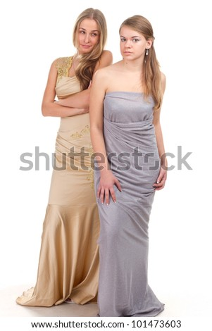 Envy of her friends - two friends in the gold and silver dress on a white background - stock photo