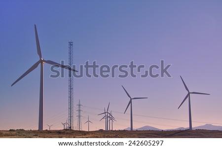 Eolian generators. Wind turbines. Green energy - stock photo