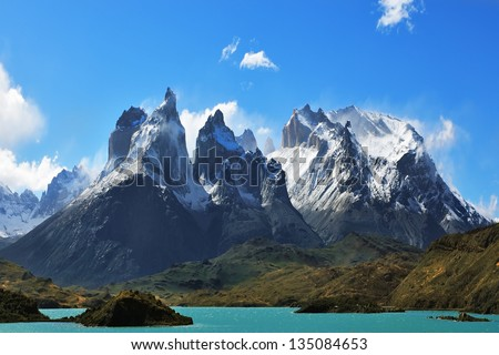 Epic beauty of the landscape - the National Park Torres del Paine in southern Chile. Cliffs of Los Kuernos in cold windy summer day - stock photo