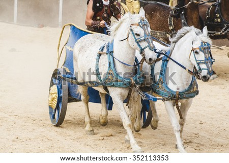 Epic, Roman chariot in a fight of gladiators, bloody circus - stock photo