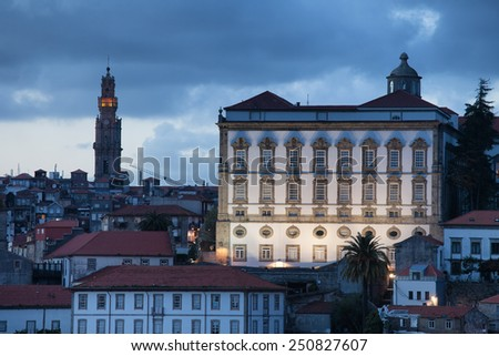 Episcopal Palace and Clerigos Church bell tower at dusk in Porto, Portugal. - stock photo