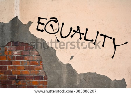 EQUALITY text sprayed on the old wall, anarchist aesthetics. Appeal to avoid any discrimination and injustice based on race, sex, sexual orientation, nationality, religiosity,. - stock photo