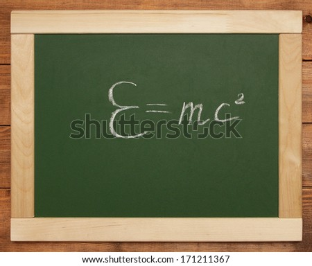 equation on a blackboard - stock photo