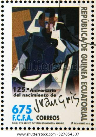EQUATORIAL GUINEA - CIRCA 2012: A stamp printed in Guinea dedicated to 125th anniversary of the birth of Juan Gris, shows Portrait de Madame Josette Gris, circa 2012   - stock photo