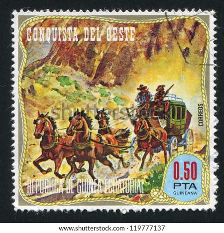 EQUATORIAL GUINEA - CIRCA 1976: stamp printed by Equatorial Guinea, shows American frontier, circa 1976 - stock photo