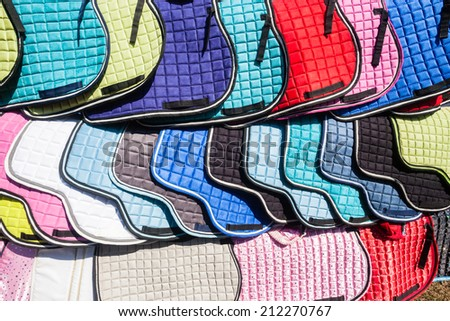 Equestrian Horse Saddle Covers Equestrian Horse saddle covers accessories on display for sale - stock photo