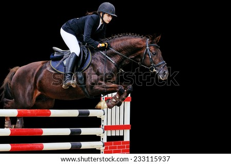 Equestrianism: Young girl in jumping show, isolated on black background - stock photo