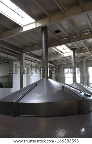 Equipment for boiling the beer at a modern brewery - stock photo